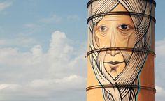 street art by nomerz transforms derelict structures