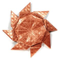 How to make an eight-pointed origami ninja star (http://www.origami-make.org/howto-origami-ninja-star.php)