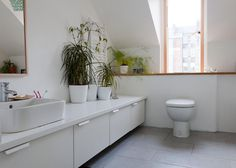 the bathroom is kitted out with a toilet, sink, and bath/shower from Jasper Morrison's line for Ideal Standard. The cabinets are from an Ike