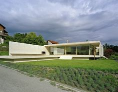 The One-Storey Slightly Inclined Modern House Overlooking the Alps