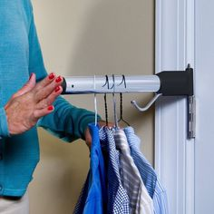 Reclaim that lost space behind your door with the hinge hanger.