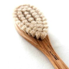 Constructed out of hard oak wood with soft horsehair bristles that are hand wired, this bath brush is made to last. #product #design #home #cosmetics