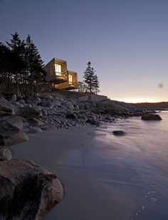 CJWHO ™ (Boat inspired wood house hanging over the ocean by...)