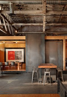 interiorslibrary:Charles Smith Wines Tasting Room by Olson Kundig Architects #loft #door #table #chairs