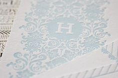 H with filigree