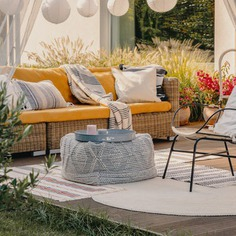 The best outdoor patio ideas bring life to your space, like bringing in this colorful assortment of patio furniture.