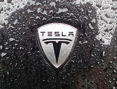 Tesla Logo #tesla #electric #wet #emblem #logo #rain #metal #car