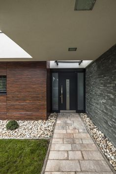 Modern Residence in Hungary Oriented Towards a Garden Pond