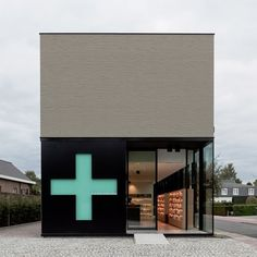 Dezeen » Blog Archive » Pharmacy M by Caan Architecten #pharmacy #modern #cross #design #architecture