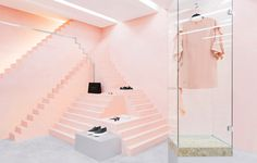 Novelty is a fashion clothing boutique designed by Anagrama branding design studio using pink tones and geometrical shapes for the space wit