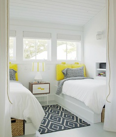 Modern bedroom with bright yellow accents