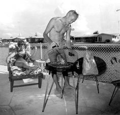 Couple outside with their grill: Cocoa Beach, Florida | Flickr - Photo Sharing! #bbq #florida #1970s #film