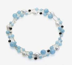 LONG NECKLACE IS DECORATED WITH SOUTH SEA CULTURED PEARLS, AQUAMARINE AND ONYX BALLS