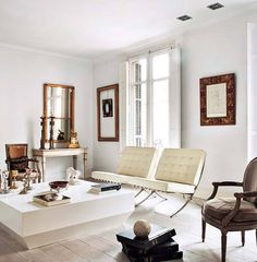Barcelona minimalist classic living room white black wood gold frames 1970s white table antique chairs
