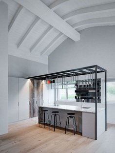 Stefano Viganò Designed a Double-Height Loft with an Industrial Personality 9
