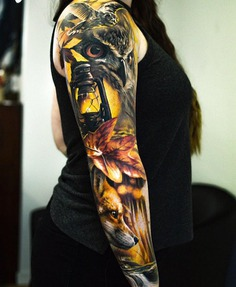 Owl oil Lampfall leaf and wolf full sleeve tattoo