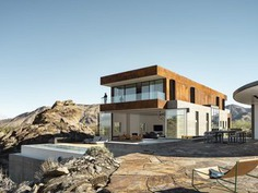 """Outdoor, Infinity Pools, Tubs, Shower, Boulders, Shrubs, Hardscapes, Walkways, Desert, Large Patio, Porch, Deck, Stone Patio, Porch, Deck, and Back Yard This Palm Springs Desert Home """"Dissolves Barriers"""" Between Indoors and Out - Photo 5 of 14 -"""