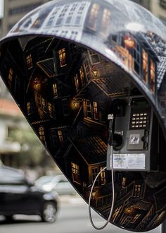 Interior of creative phone booth with town inside painted #phone #public #booth #art #street #exterior #telephone