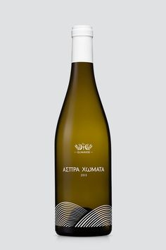 """Aspra Homata"" is a wine label of ""Domaine Glinavos"" and was named after the homonymous vineyards in Zitsa of Ioannina, Greece. This #white #greek #premium #packaging #label #wine #glinavos #traditional #domaine #silkprint #typography"