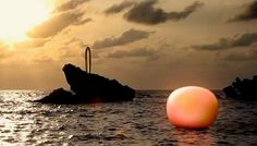 Sculpture in sea ''Changing tides'' by Mariko Mori orange color #21122012 #meditative #exhibition #sculptures #art #doomsday