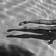 WILD THING #ripples #white #water #and #reflection #relax #paradise #black #legs #calm #photography #swim #feet