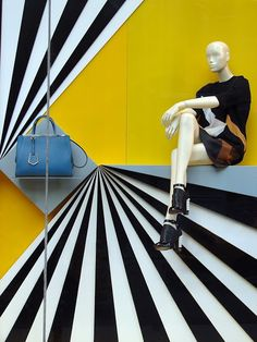 Fendi, Window Display: great use of contrast and linear eye paths... If the grey shelf holding the bag had been painted to match the yellow #pattern