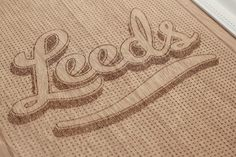 Leeds & Partners #cut #lettering #laser #wood #etching #passport #typography