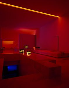Futuristic interior of the living room in dark red lighting