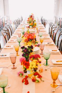 colorful centerpiece ideas - photo by Lara Hotz http://ruffledblog.com/australian-polo-club-wedding #flowers #party #decoration #wedding #co