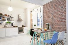 Brick accent wall in kitchen #kitchen #interiors #brick
