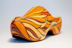 Wieden Kennedy Amsterdam // Clogwork Orange on Behance #orange #art #lines #shoes #hot