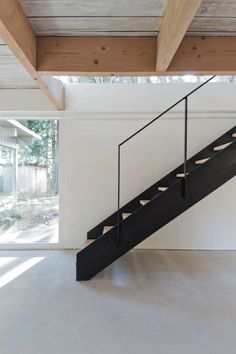 Black steel staircase. North Vancouver House by Scott & Scott Architects. #staircase