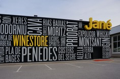Typographic signage for a liquor store - Mindsparkle Mag Pablo Rovalo from Singular Glass designed the typographic signage and placemaking project for Jané Winestore Expo-Licor, a liquor store in Barcelona. #logo #typography #identity #branding #design #color #photography #graphic #design #gallery #blog #project #mindsparkle #mag #beautiful #portfolio #designer