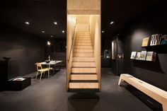 a floating staircase defines interior of bazar noir by hidden fortress #float