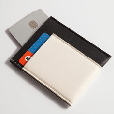 Carry only your everyday essentials with the Pocket Wallet. It features one small pocket on both the back and front of the wallet and one bigger pocket in the middle for easy access to cards, ID and a few folded cash. Made with vegan leather.