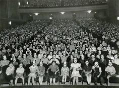 A meeting of the Mickey Mouse Club #theater #white #mickey #mouse #crowd #black #masks #masked #disney #photography #cinema #vintage #and #audience