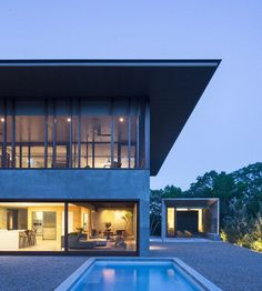 Balcones House is Like a Glass Pavilion Rising from a Solid Concrete Base 1