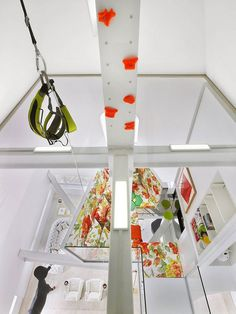 Column for climbing and artistic sofa in penthouse