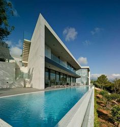 Concretus House is a Brutalist-Style Home in Cala Sardinera, Spain 1