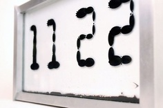 Ferrolic: Ferro Fluid Display - IPPINKA Ferrolic is a digital clock that uses ferrofluid to display different designs and times on the clock.