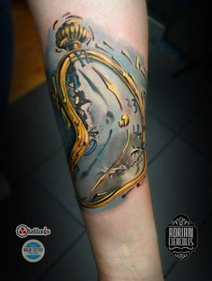 Dali melted clock tattoo on sleeve
