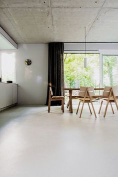 Open kitchen and dining area. House on Prenzlauer Berg by Loft Kolasiński. © Karolina Bak. #diningroom #concrete