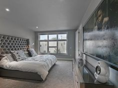 Modern bedroom with large painting