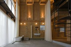 Add Some Warmth: 12 Plywood Interiors Photo #lighting #plywood #bathroom