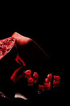 Juicy Pomegranate by Niermala B. Timmers www.niermalatimmers.com #drama #timmers #red #pomegranate #juicy #photo #fruit #bouwina #contrast #black #mirror #shiney #photography #healthy #niermala #hard #lighting #still #life #shadow