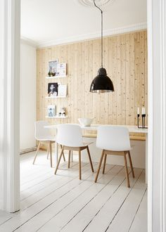 Dining room with plank floor and wall. Apartment in Vesterbro. Photo by Klix Kommunikation. #diningroom #woodfloor #woodwall #apartment