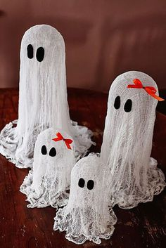 Tiny ghost figures. This miniature ghost family figure in cheesecloth looks spooky and at the same time adorable. A perfect centerpiece for