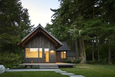 Exterior, Gable RoofLine, Wood Siding Material, Metal Roof Material, and Cabin Building Type Sleeping Cabin at sunset. Photo 7 of 19 in Island Cabins by goCstudio