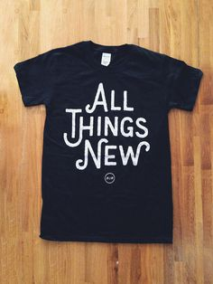 All Things New Black Tee main photo #merch #sans #tshirt #shirt #floor #wood #custom #type #band #typography