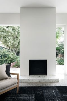 #Modern #fireplace with #marblehearth. #PrahranResidence by #WONDER. Photo by #ChristineFrancis. #modernfireplace